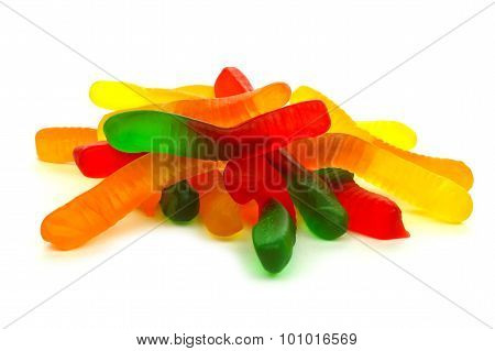 Pile of candy gummy worms over white
