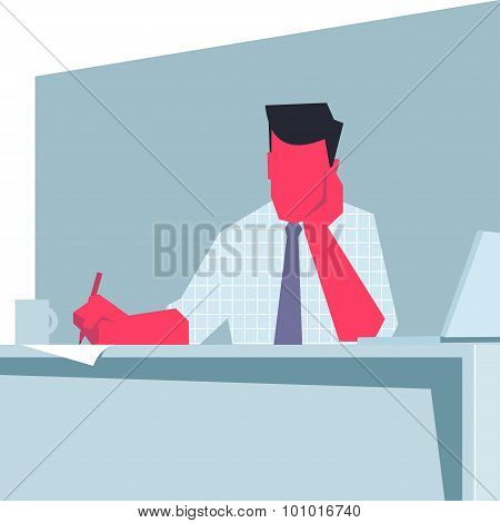 Businessman sitting at a table and writing.