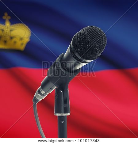 Microphone On Stand With National Flag On Background - Liechtenstein