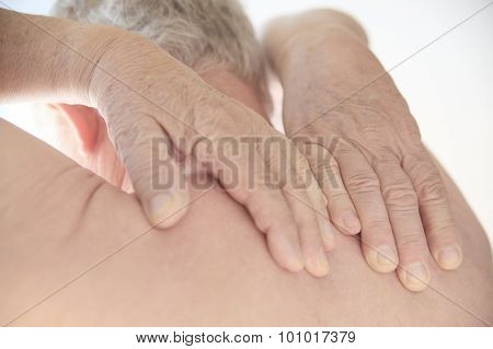 Older Man With Hands On His Bare Back