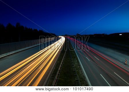 Light Trails From Car On Highway
