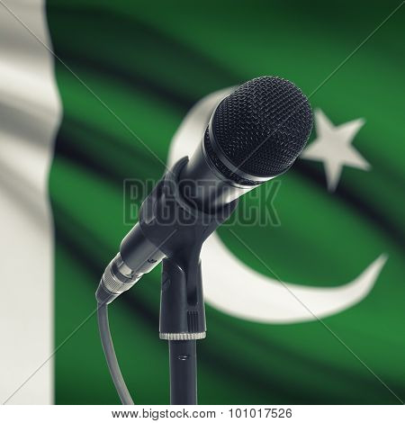 Microphone On Stand With National Flag On Background - Pakistan