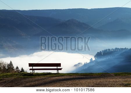 the view on bench, mountains and clouds