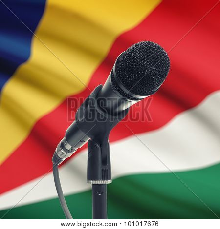 Microphone On Stand With National Flag On Background - Seychelles