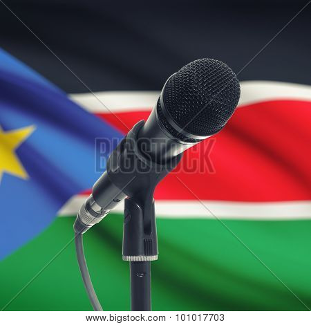 Microphone On Stand With National Flag On Background - South Sudan