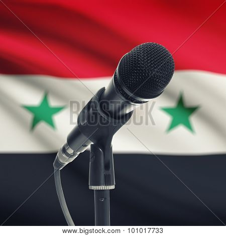 Microphone On Stand With National Flag On Background - Syria