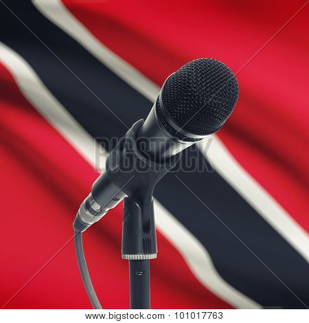 Microphone On Stand With National Flag On Background - Trinidad And Tobago