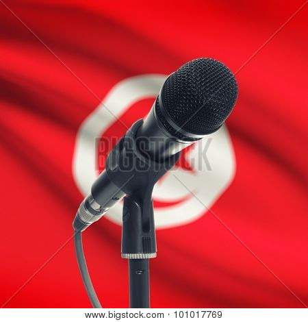 Microphone On Stand With National Flag On Background - Tunisia