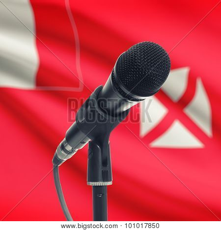 Microphone On Stand With National Flag On Background - Wallis And Futuna