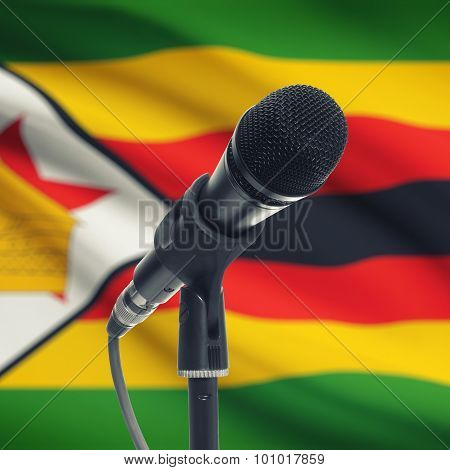 Microphone On Stand With National Flag On Background - Zimbabwe