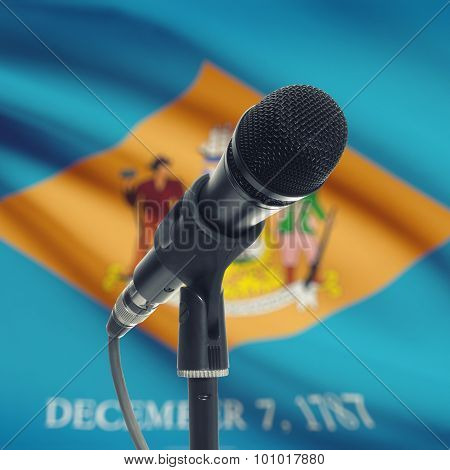 Microphone On Stand With Us State Flag On Background - Delaware