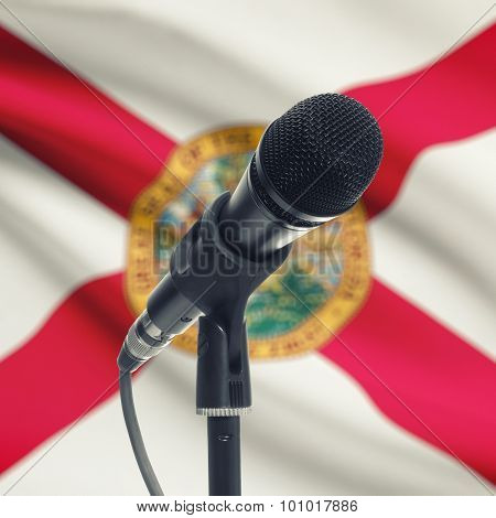 Microphone On Stand With Us State Flag On Background - Florida