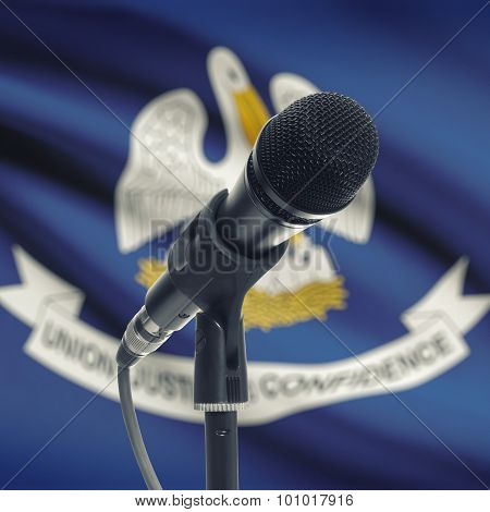 Microphone On Stand With Us State Flag On Background - Louisiana