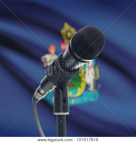Microphone On Stand With Us State Flag On Background - Maine