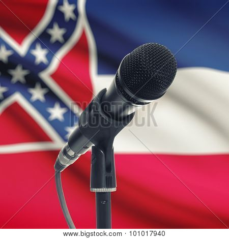 Microphone On Stand With Us State Flag On Background - Mississippi