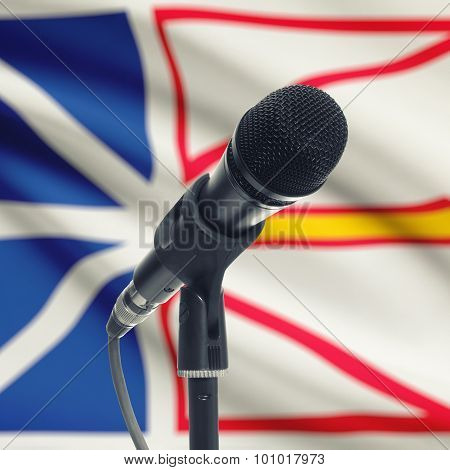 Microphone On Stand With Canadian Province Flag On Background - Newfoundland And Labrador