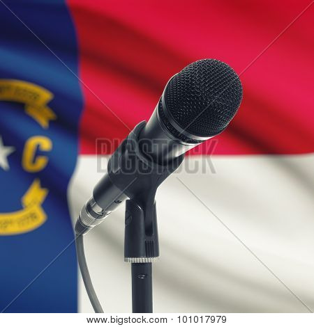 Microphone On Stand With Us State Flag On Background - North Carolina