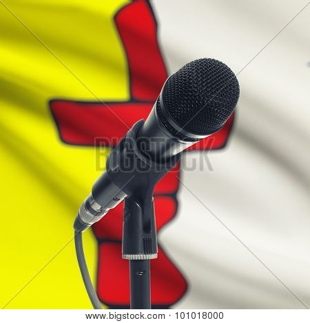 Microphone On Stand With Canadian Province Flag On Background - Nunavut