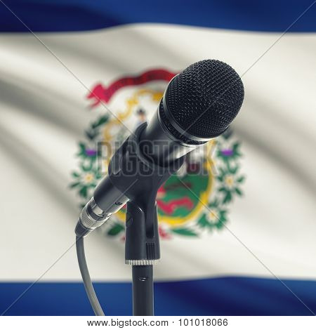 Microphone On Stand With Us State Flag On Background - West Virginia