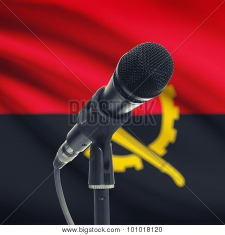 Microphone On Stand With National Flag On Background - Angola