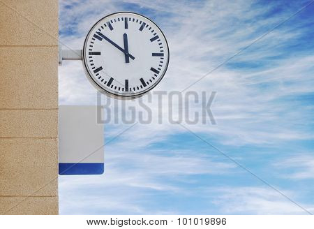 Clock and plate for information at train station