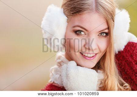 Portrait Of Pretty Smiling Woman In White Earmuffs.