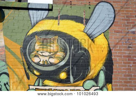 Street art Montreal bee on bike.