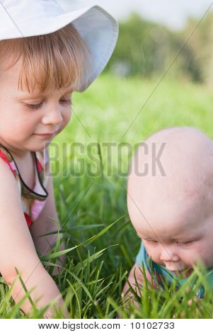 Two Children On The Grass