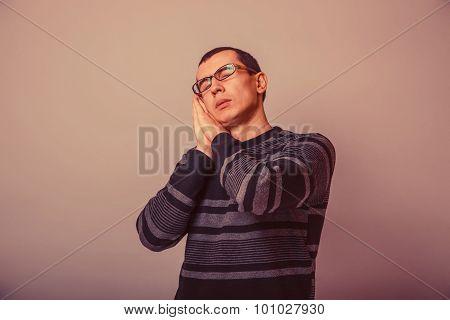 European-looking man of 30 years  in glasses  wants to sleep ret