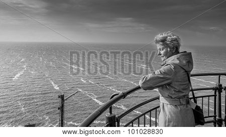 Senior Woman fascinated by a Storm