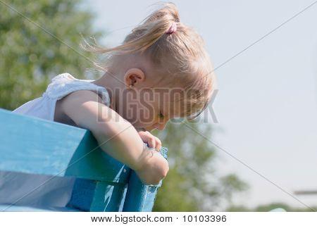 Dreamy Girl On Bench