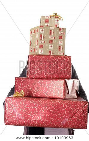 Person Holding And Hidden Behind A Stack Of Christmas Presents