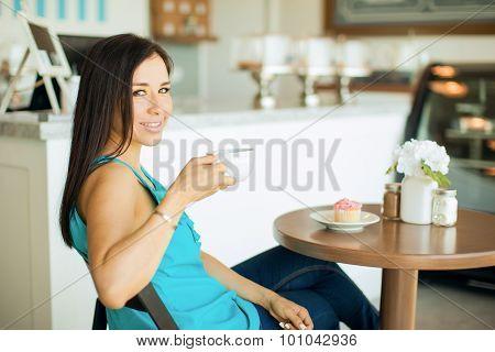 Cute Brunette Drinking Coffee