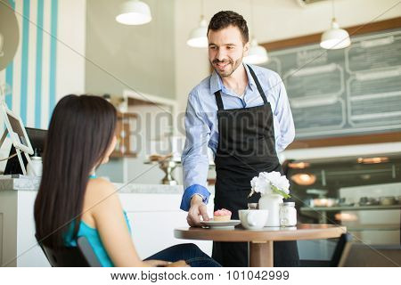 Waiter In A Coffee Shop