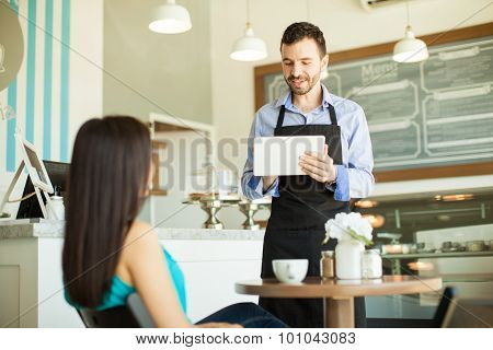 Waiter Taking Order With A Tablet