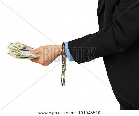 Man In A Black Suit With Dollars And A Card In The Hands With Handcuffs