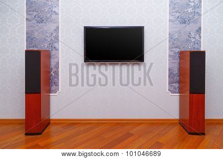 Empty interior of room with TV and speakers