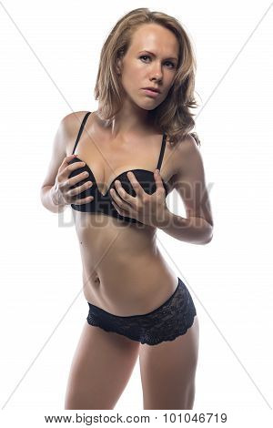 Exciting woman in black underwear on white background