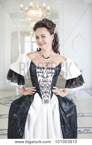 Beautiful Young Woman In Long Medieval Dress Winking