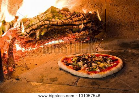 Pizza in a wood oven