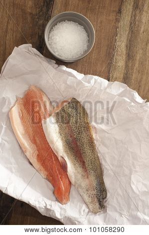 Rainbow Trout Meat On A Table With Salt