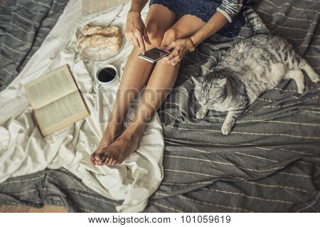 Beautiful Woman Model With Coffee, Pastries, Home Phone On The Blanket With A Cat