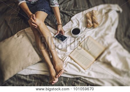 Beautiful Woman Model With Coffee, Pastries, Home Phone On The Blanket