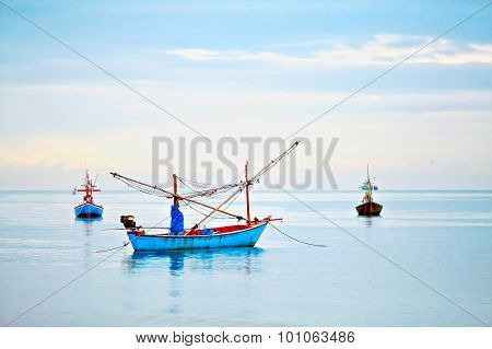Three boats on the sea