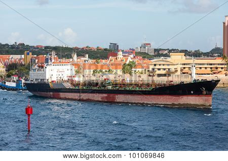 Tug Pushing Tanker In Curacao