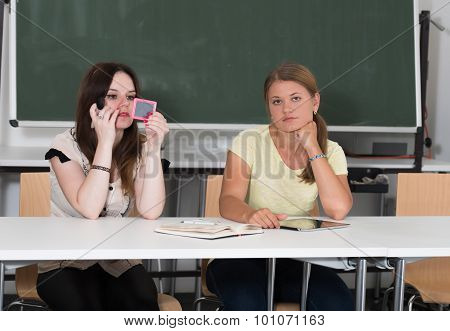 Two Students Studying And Learning In University
