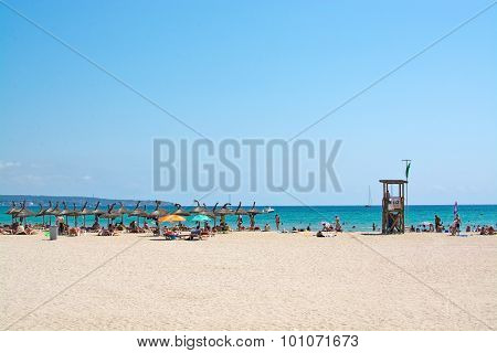 Beach With Parasols And Lifeguard