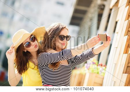 Selfie on the street for two beautiful women.