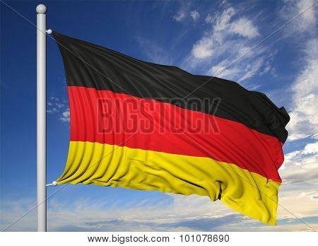 Waving flag of Germany on flagpole, on blue sky background.