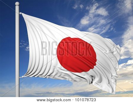 Waving flag of Japan on flagpole, on blue sky background.